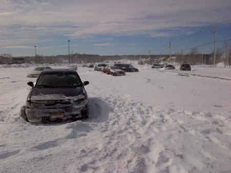 "<div class=""meta image-caption""><div class=""origin-logo origin-image ""><span></span></div><span class=""caption-text"">Cars got stranded on Nesconsett Highway after the storm that covered Suffolk County with snow.</span></div>"