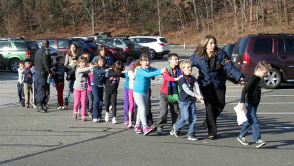 Scene outside Sandy Hook Elementary in Newtown, Connecticut following reported shooting on Friday, December 14, 2012. (Shannon Hicks/The Newton Bee)