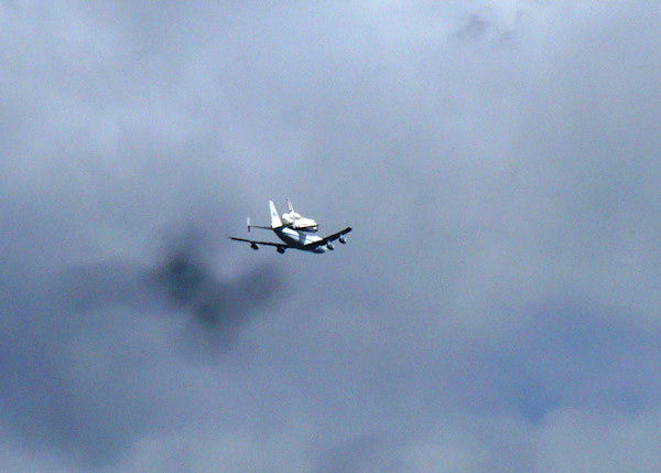 Our own N.J. Burkett took this picture of the Enterprise as it flew over the Intrepid.
