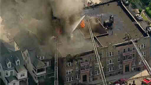 "<div class=""meta ""><span class=""caption-text "">Large flames were seen out of a building in Passaic, New Jersey.  The fire was near Passaic High School that was forced to evacuate.</span></div>"