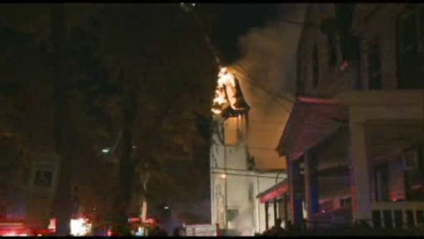 "<div class=""meta image-caption""><div class=""origin-logo origin-image ""><span></span></div><span class=""caption-text"">Firefighters battled a fire that tore through a church in Perth Amboy, New Jersey early Monday morning.</span></div>"