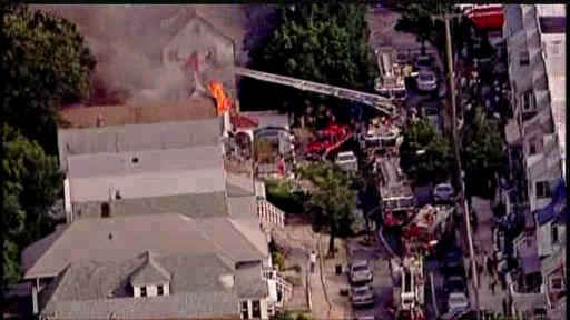 A three alarm fire burned through two homes on 112th Street in Richmond Hill, Queens.   <span class=meta>(WABC Photo)</span>