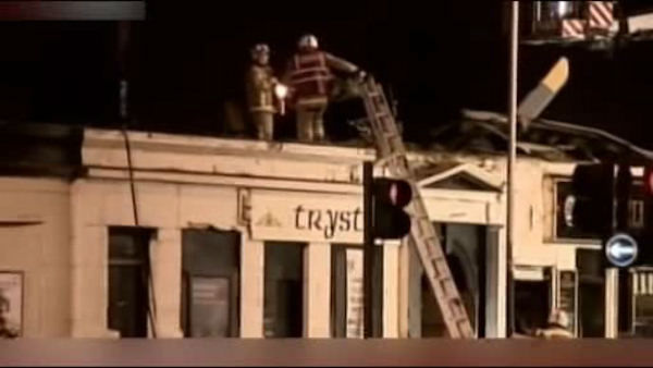 Scottish emergency workers were sifting through wreckage Saturday for survivors of a police helicopter crash onto a crowded Glasgow pub that has killed at least eight people.