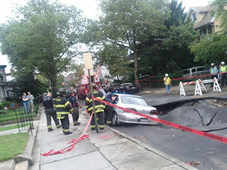 A giant sinkhole swallowed three cars on 79th Street between 4th and 5th Avenues in Bay Ridge, Brooklyn on Wednesday. <span class=meta>(WABC Photo&#47; Gregory Kurgansky)</span>