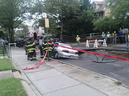 "<div class=""meta image-caption""><div class=""origin-logo origin-image ""><span></span></div><span class=""caption-text"">A giant sinkhole swallowed three cars on 79th Street between 4th and 5th Avenues in Bay Ridge, Brooklyn on Wednesday. (WABC Photo/ Gregory Kurgansky)</span></div>"