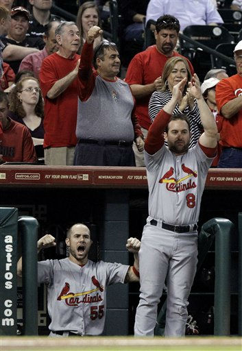St. Louis Cardinals Skip Schumaker &#40;55&#41; and Nick Punto &#40;8&#41; cheer as Jon Jay scores on an Albert Pujols single in the first inning against the Houston Astros in a baseball game Wednesday, Sept. 28, 2011, in Houston. &#40;AP Photo&#47;Pat Sullivan&#41; <span class=meta>(AP Photo&#47; Pat Sullivan)</span>
