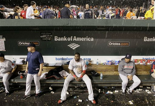 Boston Red Sox designated hitter David Ortiz, center, sits in the dugout in a rain delay in the seventh inning of the Red Sox&#39;s baseball game against the Baltimore Orioles on Wednesday, Sept. 28, 2011, in Baltimore. &#40;AP Photo&#47;Patrick Semansky&#41; <span class=meta>(AP Photo&#47; Patrick Semansky)</span>