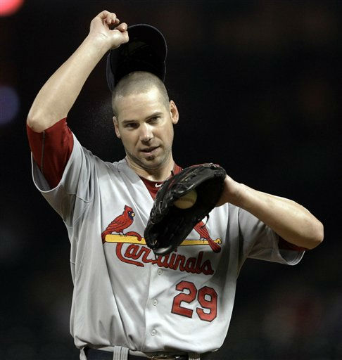 St. Louis Cardinals starting pitcher Chris Carpenter adjusts his cap during the sixth inning of a baseball game against the Houston Astros on Wednesday, Sept. 28, 2011, in Houston. &#40;AP Photo&#47;David J. Phillip&#41; <span class=meta>(AP Photo&#47; David J. Phillip)</span>
