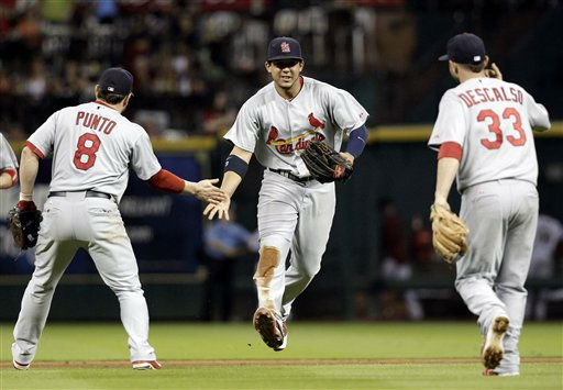 St. Louis Cardinals&#39; Jon Jay, center, celebrates with teammates Nick Punto &#40;8&#41; and Daniel Descalso &#40;33&#41; after the Cardinals&#39; 8-0 win over the Houston Astros in a baseball game Wednesday, Sept. 28, 2011, in Houston. &#40;AP Photo&#47;David J. Phillip&#41; <span class=meta>(AP Photo&#47; David J Phillip)</span>