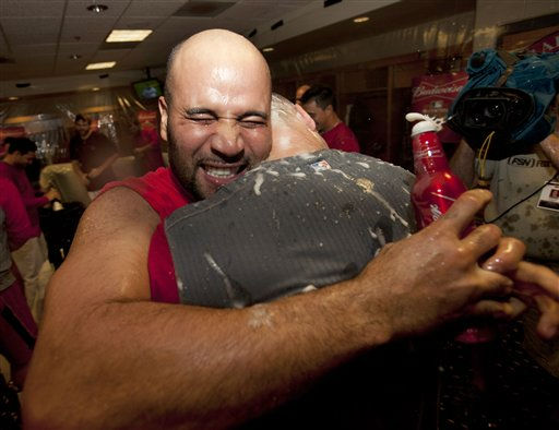 St. Louis Cardinals&#39; Albert Pujols, left, and Skip Schumaker celebrate the team&#39;s wild-card berth for the baseball playoffs, Wednesday, Sept. 28, 2011, in Houston. The Cardinals beat the Houston Astros 8-0 and the Philadelphia Phillies beat the Atlanta Braves 4-3, giving the Cardinals the playoff spot. &#40;AP Photo&#47;David J. Phillip&#41; <span class=meta>(AP Photo&#47; David J Phillip)</span>