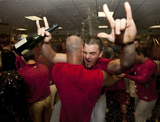 St. Louis Cardinals&#39; Ryan Theriot and his teammates celebrate their wild-card berth in the National League baseball playoffs, after beating the Houston Astros 8-0 Wednesday, Sept. 28, 2011, in Houston. The win coupled with the Atlanta Braves&#39; loss to the Philadelphia Phillies put the Cardinals in the playoffs. &#40;AP Photo&#47;David J. Phillip&#41; <span class=meta>(AP Photo&#47; David J Phillip)</span>