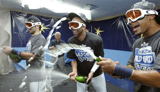 Tampa Bay Rays, from left, Sean Rodriguez, David Price, and Desmond Jennings spray champagne as they celebrate early Thursday, Sept. 29, 2011, after the Rays clinched the AL wild card with an 8-7 win over the New York Yankees in a baseball game in St. Petersburg, Fla. &#40;AP Photo&#47;Mike Carlson&#41; <span class=meta>(AP Photo&#47; Mike Carlson)</span>