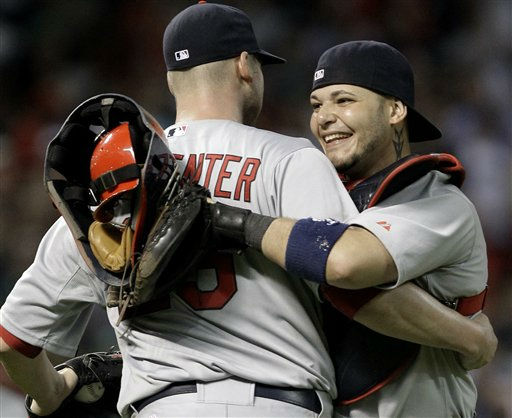 St. Louis Cardinals catcher Yadier Molina and pitcher Chris Carpenter celebrate the Cardinals&#39; 8-0 win over the Houston Astros in a baseball game Wednesday, Sept. 28, 2011, in Houston. &#40;AP Photo&#47;Pat Sullivan&#41; <span class=meta>(AP Photo&#47; Pat Sullivan)</span>