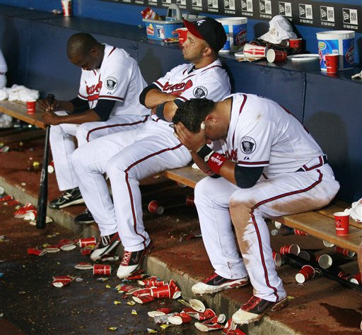 Atlanta Braves, from left, Cristhian Martinez, Alex Gonzalez and Martin Pardo sit on the bench after the Braves&#39; 4-3 loss to the Philadelphia Phillies in 13 innings in a baseball game in Atlanta on Wednesday, Sept. 28, 2011. The loss and the St. Louis Cardinals&#39; win ended the Braves&#39; season. &#40;AP Photo&#47;John Bazemore&#41; <span class=meta>(AP Photo&#47; John Bazemore)</span>