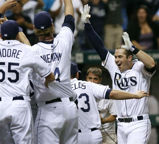 Tampa Bay Rays&#39; Evan Longoria, right, celebrates with teammates after his home run in the 12th inning against the New York Yankees during a baseball game early Thursday, Sept. 29, 2011, in St. Petersburg, Fla. The Rays defeated the Yankees 8-7 and won the AL wild card. &#40;AP Photo&#47;Chris O&#39;Meara&#41; <span class=meta>(AP Photo&#47; Chris O&#39;Meara)</span>