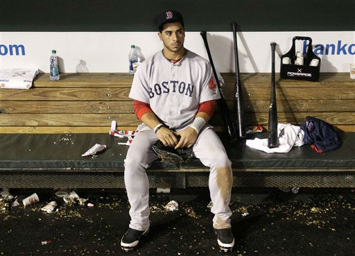 Boston Red Sox third baseman Mike Aviles sits in the dugout after Boston&#39;s 4-3 loss to the Baltimore Orioles in a baseball game Wednesday, Sept. 28, 2011, in Baltimore. Boston was eliminated from the playoffs after the Tampa Bay Rays beat the New York Yankees in extra innings minutes after Boston&#39;s loss. &#40;AP Photo&#47;Patrick Semansky&#41; <span class=meta>(AP Photo&#47; Patrick Semansky)</span>