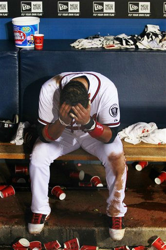 Atlanta Braves left fielder Martin Prado sits on the bench after the Braves lost 4-3 in 13 innings in a baseball game to the Philadelphia Phillies in Atlanta on Wednesday, Sept. 28, 2011. &#40;AP Photo&#47;John Bazemore&#41; <span class=meta>(AP Photo&#47; John Bazemore)</span>