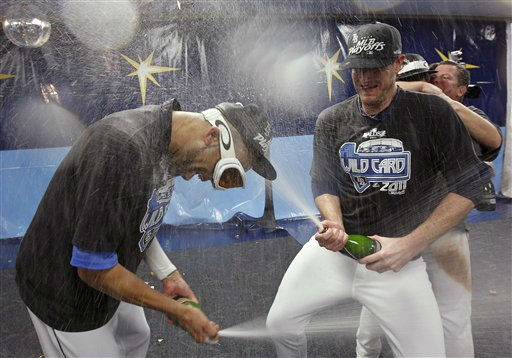 Tampa Bay Rays&#39; David Price, left, and Jeff Niemann celebrate early Thursday, Sept. 29, 2011, after the Rays clinched the AL wild card with an 8-7 win over the New York Yankees in a baseball game in St. Petersburg, Fla. &#40;AP Photo&#47;Mike Carlson&#41; <span class=meta>(AP Photo&#47; Mike Carlson)</span>