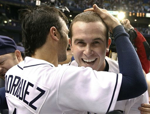 Tampa Bay Rays&#39; Evan Longoria, right, hugs teammate Sean Rodriguez after hitting a walkoff home run off New York Yankees relief pitcher Scott Proctor during a baseball game early Thursday, Sept. 29, 2011, in St. Petersburg, Fla. The Rays won the game 8-7 and clinched the AL wild card. &#40;AP Photo&#47;Chris O&#39;Meara&#41; <span class=meta>(AP Photo&#47; Chris O&#39;Meara)</span>