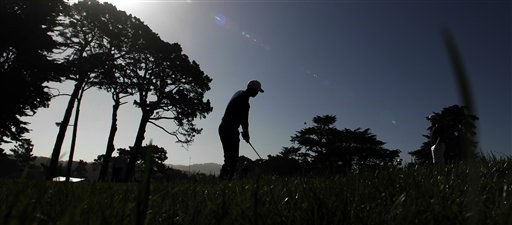 Tiger Woods hits a chip shot on the seventh hole during a practice round for the U.S. Open Championship golf tournament Tuesday, June 12, 2012, at The Olympic Club in San Francisco. &#40;AP Photo&#47;Charlie Riedel&#41; <span class=meta>(AP Photo&#47; Charlie Riedel)</span>