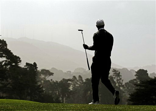 Tiger Woods walks off the 17th green during the first round of the U.S. Open Championship golf tournament Thursday, June 14, 2012, at The Olympic Club in San Francisco. &#40;AP Photo&#47;Charlie Riedel&#41; <span class=meta>(AP Photo&#47; Charlie Riedel)</span>