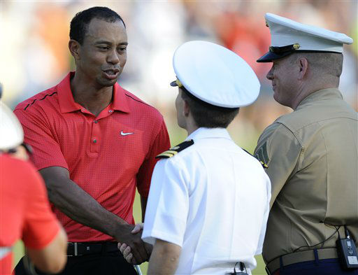 Tiger Woods shakes hands with members of the military on the 18th hole during the final round of the AT&#38;T National Golf tournament, Sunday, July 1, 2012, in Bethesda, Md. &#40;AP Photo&#47;Nick Wass&#41; <span class=meta>(AP Photo&#47; Nick Wass)</span>