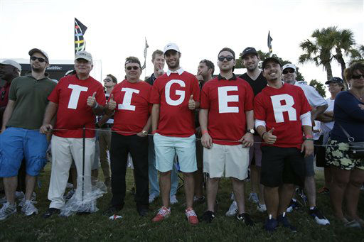 Tiger Woods fans on the 18th fairway during the third round of the Cadillac Championship golf tournament Sunday, March 10, 2013, in Doral, Fla. &#40;AP Photo&#47;Wilfredo Lee&#41; <span class=meta>(AP Photo&#47; Wilfredo Lee)</span>