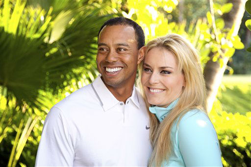 In this 2013 photo provided by Tiger Woods and Lindsey Vonn, golfer Tiger Woods and skier Lindsey Vonn pose for a portrait. Two months after rumors began circulating in Europe, Woods and Vonn posted separate items on their Facebook pages Monday, March 18, 2013, to announce their relationship. &#40;AP Photo&#47;Courtesy Tiger Woods&#47;Lindsey Vonn&#41; MANDATORY CREDIT TO COURTESY TIGER WOODS&#47;LINDSEY VONN <span class=meta>(AP Photo&#47; Uncredited)</span>