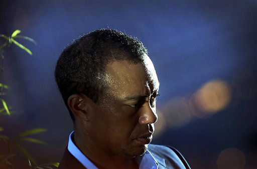 American golfer Tiger Woods is in the spotlight at the Marina Bay Sands on Thursday, Nov. 1, 2012 in Singapore. Woods is in the city-state to attend golf clinics in a bid to promote and inspire young golfers from the Singapore Sports School.&#40;AP Photo&#47;Wong Maye-E&#41; <span class=meta>(AP Photo&#47; Wong Maye-E)</span>