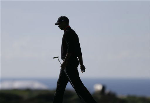 Tiger Woods is silhouetted as he walks across the 14th green during the final round in the Farmers Insurance Open golf tournament Monday, Jan. 28, 2013, in San Diego. &#40;AP Photo&#47;Lenny Ignelzi&#41; <span class=meta>(AP Photo&#47; Lenny Ignelzi)</span>
