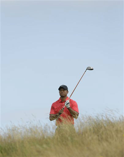 "<div class=""meta ""><span class=""caption-text "">Tiger Woods of the United States plays a shot off the 11th tee at Royal Lytham & St Annes golf club during the final round of the British Open Golf Championship, Lytham St Annes, England Sunday, July  22, 2012. (AP Photo/Jon Super) (AP Photo/ Jon Super)</span></div>"