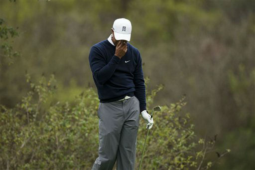 "<div class=""meta image-caption""><div class=""origin-logo origin-image ""><span></span></div><span class=""caption-text"">Tiger Woods reacts after hitting a pour tee shot during the first round of the World Challenge golf tournament at Sherwood Country Club in Thousand Oaks, Calif., Thursday, Nov. 29, 2012. (AP Photo/Bret Hartman) (AP Photo/ Bret Hartman)</span></div>"