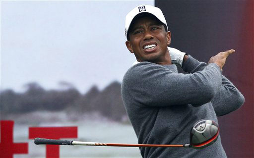 Tiger Woods lets go of his club after his tee shot on the first hole during his 18-hole medal-match against Rory McIlroy at the Lake Jinsha Golf Club in Zhengzhou, in central China&#39;s Henan province, Monday, Oct. 29, 2012. &#40;AP Photo&#47;Alexander F. Yuan&#41; <span class=meta>(AP Photo&#47; Alexander F. Yuan)</span>