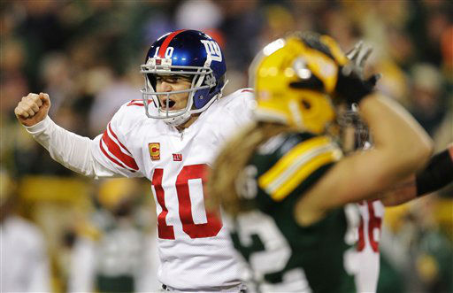 New York Giants quarterback Eli Manning reacts in front of Green Bay Packers linebacker Clay Matthews, right, after throwing a 37-yard touchdown pass to Hakeem Nicks during the first the first half of an NFL divisional playoff football game Sunday, Jan. 15, 2012, in Green Bay, Wis. &#40;AP Photo&#47;Darron Cummings&#41; <span class=meta>(AP Photo&#47; Darron Cummings)</span>