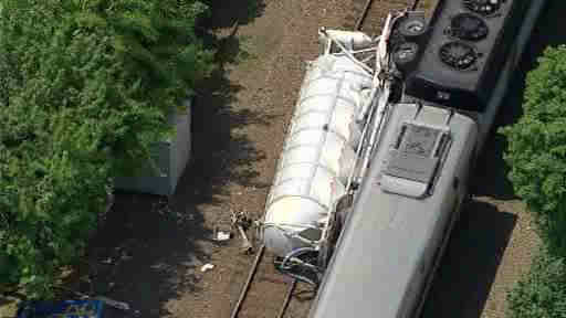 "<div class=""meta image-caption""><div class=""origin-logo origin-image ""><span></span></div><span class=""caption-text"">A train struck at a truck at a crossing in Bergen County, forcing New Jersey Transit to suspend service on the Bergen Line.</span></div>"