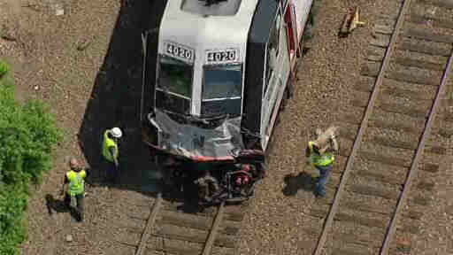 A train struck at a truck at a crossing in Bergen County, forcing New Jersey Transit to suspend service on the Bergen Line.