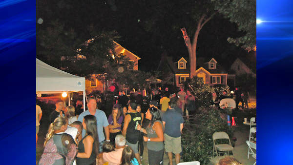 Four people were hurt Saturday night when a tree limb fell at a block party in New Hyde Park, Long Island.   Photo courtesy  Geoffrey Walter, New Hyde Park Patch