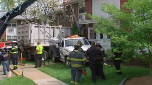 A truck driver was injured after his dump truck crashed into an apartment building in Paterson, New Jersey.
