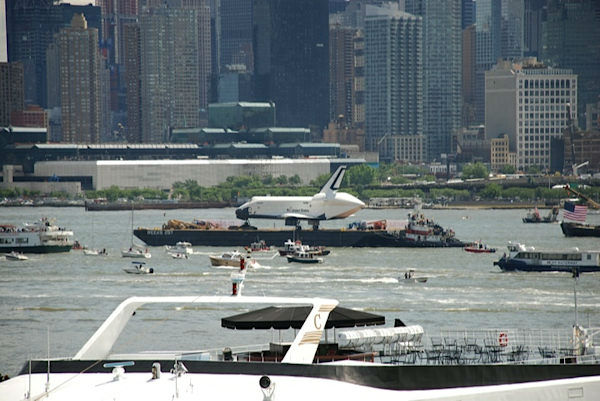 Viewer photos of the Shuttle Enterprise as it was moved to the Intrepid.