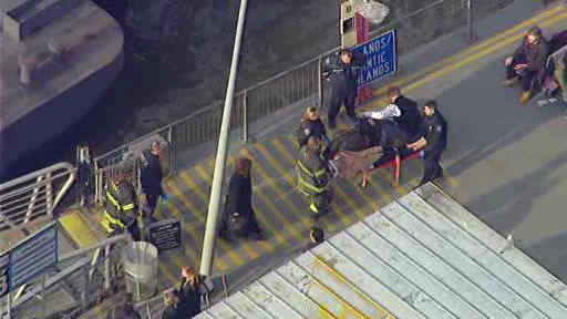 A commuter ferry had a hard landing when it pulled into a Lower Manhattan pier, injuring more than a dozen people.