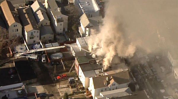 "<div class=""meta ""><span class=""caption-text "">NewsCopter 7 over a multi-alarm fire involving several homes in Bayonne, New Jersey.</span></div>"