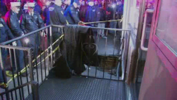 "<div class=""meta image-caption""><div class=""origin-logo origin-image ""><span></span></div><span class=""caption-text"">Rescuers saved a woman who fell through a hole in the sidewalk Friday night at East 60th Street and Second Avenue in Manhattan.</span></div>"