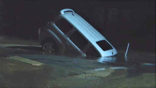 "<div class=""meta image-caption""><div class=""origin-logo origin-image ""><span></span></div><span class=""caption-text"">A large sinkhole in Long Island swallowed up a car that a New York postal worker was driving in.</span></div>"