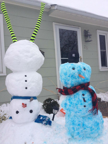 An upside down snow man and a blue Yankee snow man.