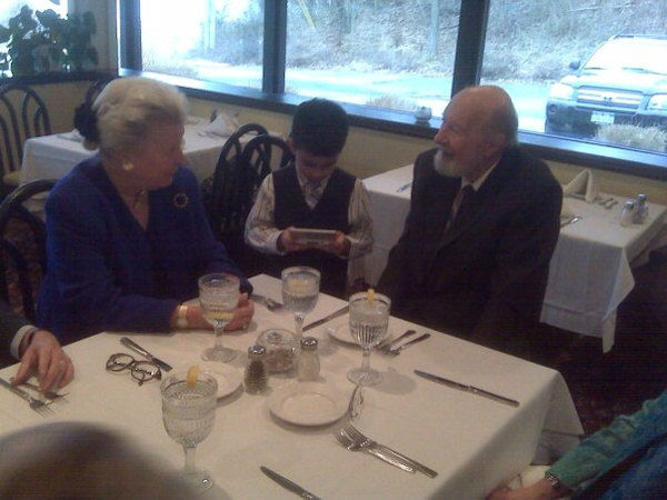 This photo was taken by Eyewitness News photographer Calvin B. De Mond at lunch after the St. Luke's MLK Tribute with Fr. Edwin Cromey and Pete Seeger.  Pete had observed Calvin's son Theodore playing games on his Nintendo DS and inquired as to what he was doing. Theodore explained to him how it worked.  After lunch Pete pulled Calvin aside and told me that I had one smart little boy.    From left to right, Pamela Cromey, Theodore De Mond and Pete Seeger in Beacon, NY on January 19, 2010.