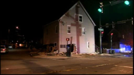A police chase ended early Tuesday when the suspect's car slammed into a house in New Haven, coming to rest inside a bedroom and on top of a sleeping man.