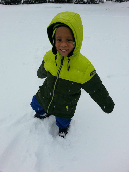 Zaire playing in the snow