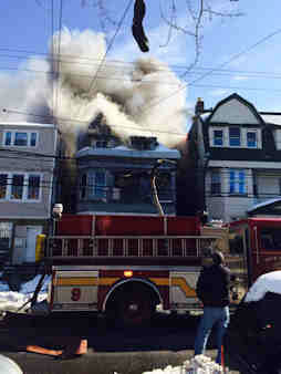"<div class=""meta image-caption""><div class=""origin-logo origin-image ""><span></span></div><span class=""caption-text"">A fire displaced residents in a multi-family home in Newark, New Jersey on Friday, Feb. 7, 2014.</span></div>"