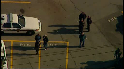 "<div class=""meta ""><span class=""caption-text "">NewsCopter 7 over the scene where court officers shot a suspect armed with a rifle who opened fire in the lobby of Middletown City Court.</span></div>"