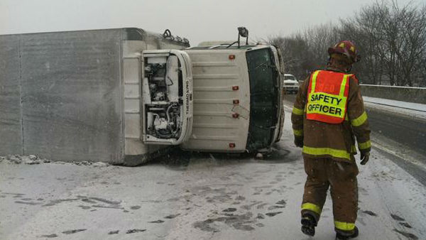 Truck carrying vegetables with full tank of diesel flips on icy highway, no injuries